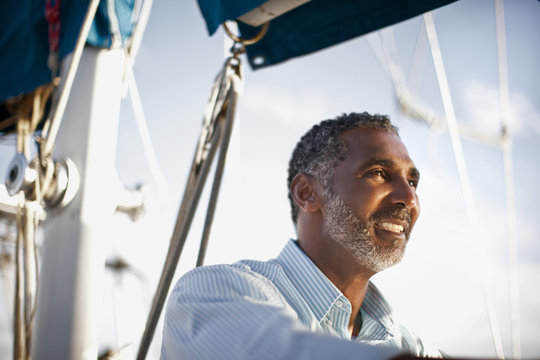 Mature man looking at view from boat.