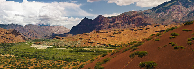 Panoramic shot of rocky canyon landscape.