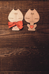 Two wooden cat with a red bow and valentine