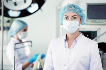 Young doctor in operating room of modern clinic