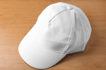 White cap for branding on wooden background