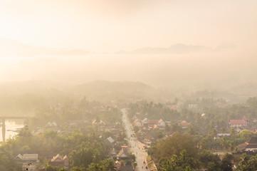 sunburst over Luang Prabang at sunrise