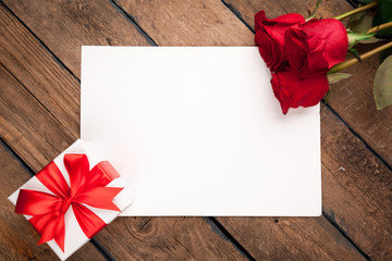 Red roses, gift box and Valentine's day card