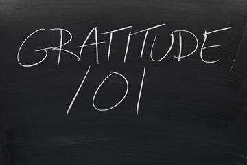 """The words """"Gratitude 101"""" on a blackboard in chalk"""