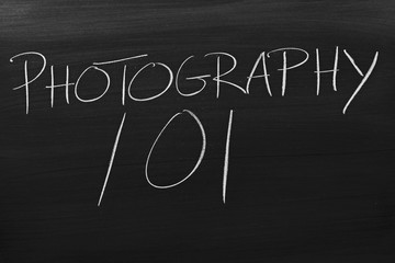 "The words ""Photography 101"" on a blackboard in chalk"