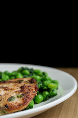 Healthy chicken medallions with peas and spinach