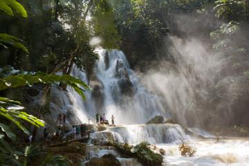 LUANG PRABANG, LAOS - OCTOBER 10: Unidentified tourists at the main waterfall at Kuang Si Waterfall near Luang Prabang, Laos on October 10, 2014.