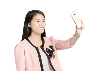 portrait of a beautiful asian girl selfie with smart phone. Isol