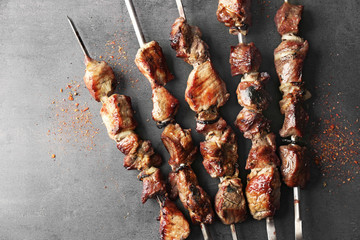 Fresh tasty barbecue on grey background