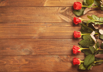 Keuken foto achterwand Roses Bouquet of beautiful red roses on wooden background