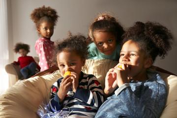 Cute African girls having fun at home