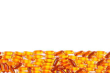 Orange medical capsules on white background, health care concept, copy space for text