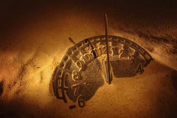 Sundial in sand