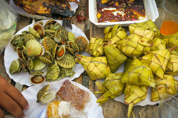 Assortment of Filipino Picnic Foods on the Beach