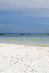 Perfect deserted white sand beach with the tropical sea (Malibu Beach, Koh Phangan Island, Thailand). Vertical.