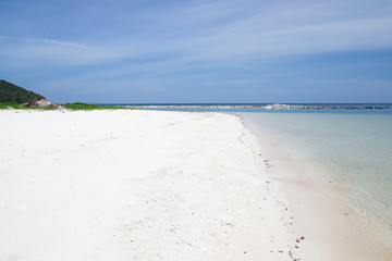 Perfect deserted white sand beach with the tropical sea (Malibu Beach, Koh Phangan Island, Thailand).
