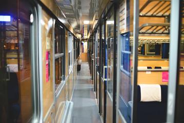 Inside an empty passenger car high-speed train in the evening.