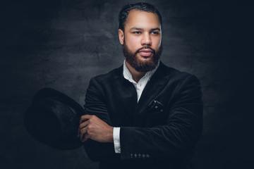 Black man wearing a suit and a felt hat.