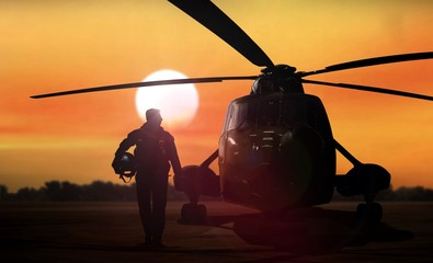 Printed kitchen splashbacks Helicopter Helicopter silhouette on the ground during sunset
