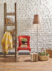 stairs and brick wall decoration with lamp and red chair