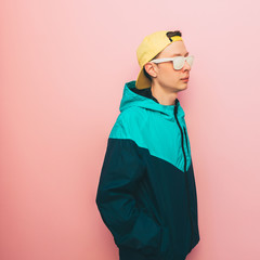 the man with glasses and cap. trendy jacket in rave style and the 90s. minimalism and pastel colors.