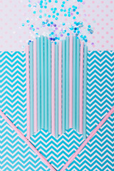 abstract composition for Valentine's day. drinking straws laid in the form of heart on background with zigzag pattern