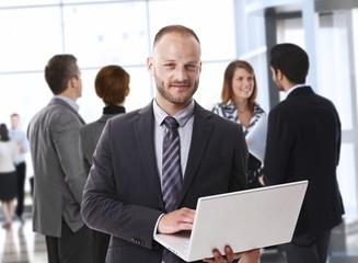 Corporate caucasian businessman with laptop