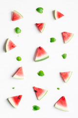 Pattern made of watermelon slices on white background. Top view, flat lay