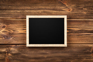 Fotoväggar - Picture frame on a wooden wall