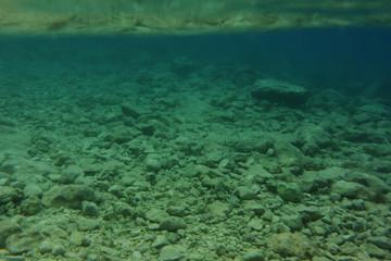 Underwater rocky seabed.