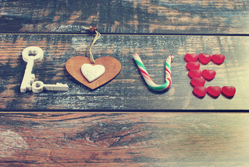 the word LOVE made of various objects in vintage style