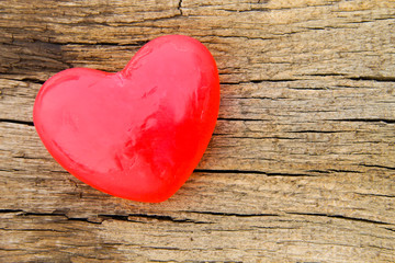 Heart shaped soap on wooden background
