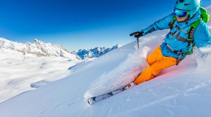 Wall Mural - Freerider skier running downhill