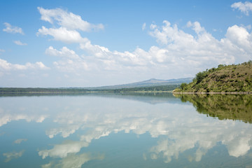 Blue sky reflected in waters of Elmenteita Lake, Kenya
