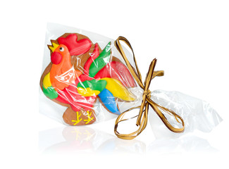 Rooster Gingerbread in transparent packing with a bow.