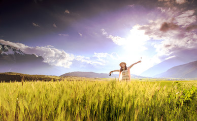 Girl cheering in the wheat field