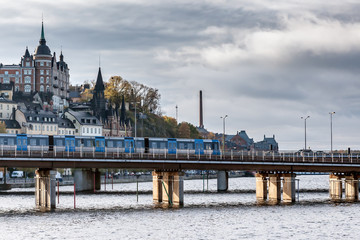 the train of the subway goes on the center of Stockholm in clear autumn day
