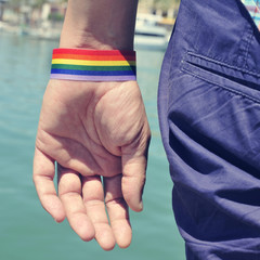 man with a rainbow flag painted in his wrist