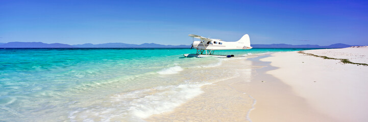 A seaplane on a sand island on the Great Barrier Reef in Australia