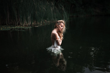 girl standing in the lake