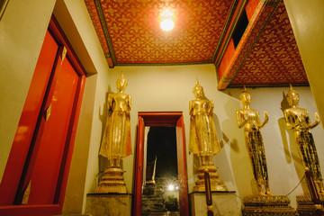 Buddha statue and  thai door art architecture in Wat Phra Chetupon Vimolmangklararm (Wat Pho) temple, Thailand.
