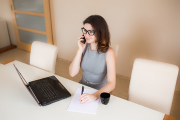 Business woman working at the computer