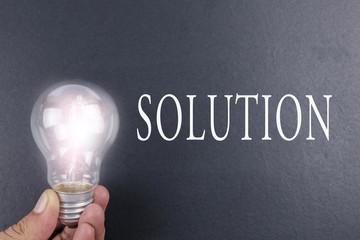 Idea concept of  IDEA. Light of bulb on grey background. Low light