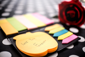 Post-it with message love you forever. Collection of different colored sheets of note papers and Red Roses flower for Valentine Day . Customize colors Vintage retro and old film Tone