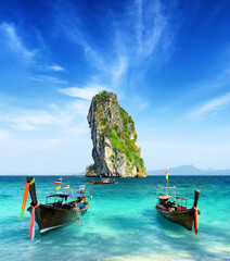 Two boats and a rock in the sea. Krabi province