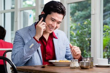 Handsome young businessman talking on a mobile