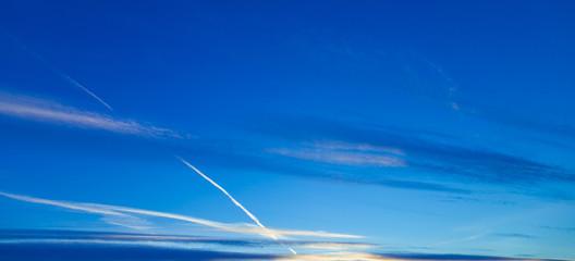 horizontal clouds on a blue evening sky