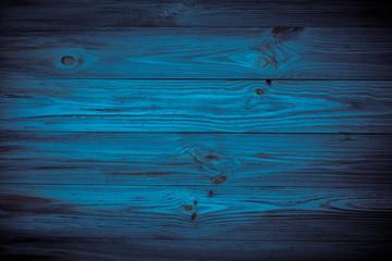 Dark blue background wooden texture.