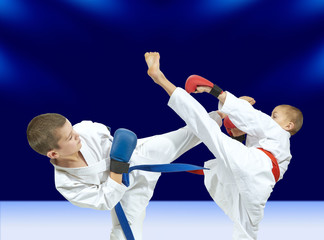 Blows legs athletes are beating with red and blue belt