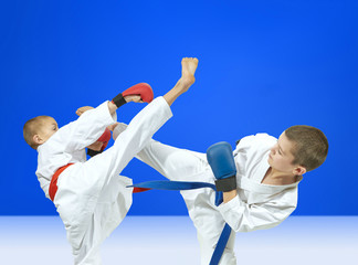 With red and blue belt the sportsmen are beating kick leg